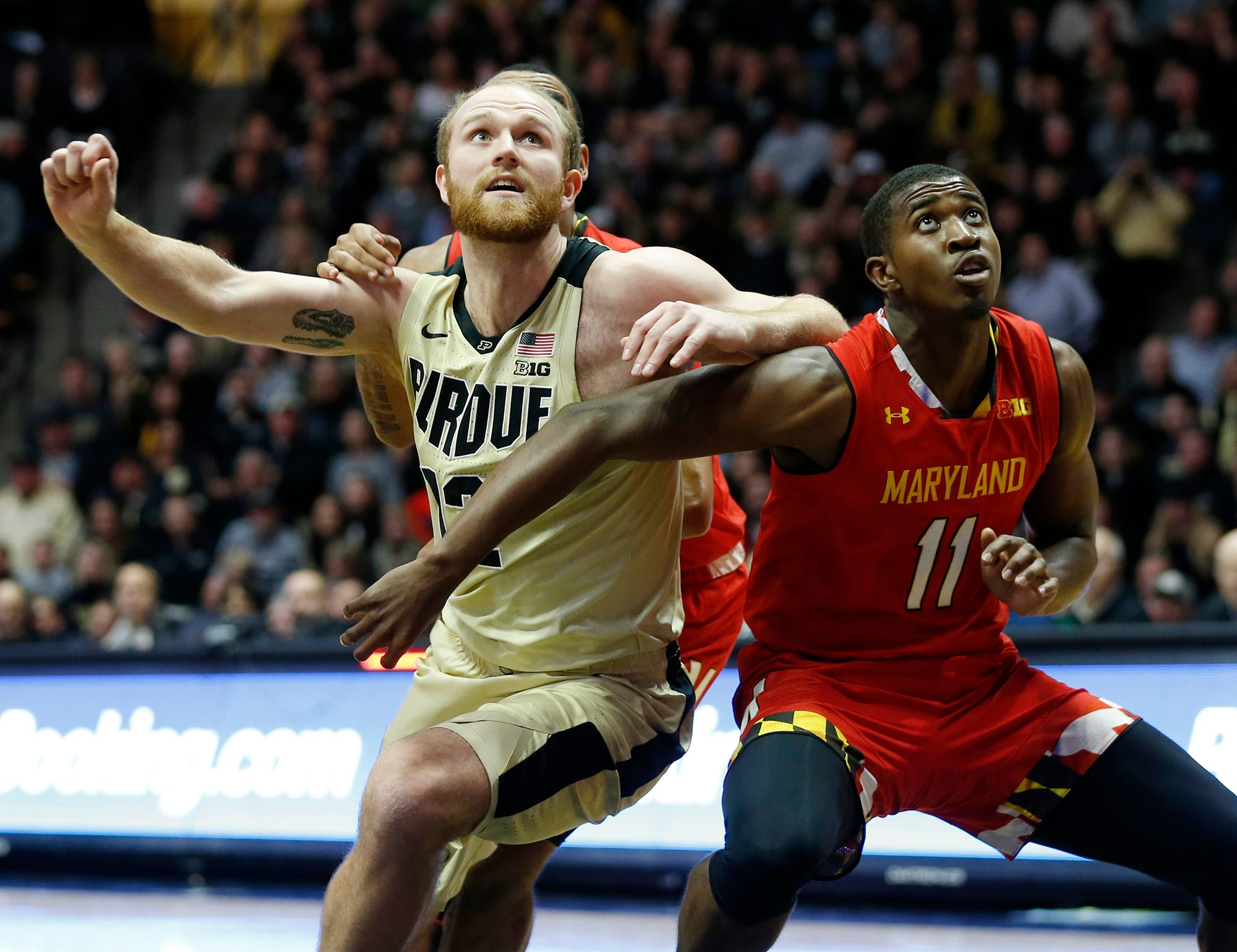 Evan Boudreaux of Purdue wrestles with Darryl Morsell of Maryland for position Thursday, December 6, 2018, at Mackey Arena.