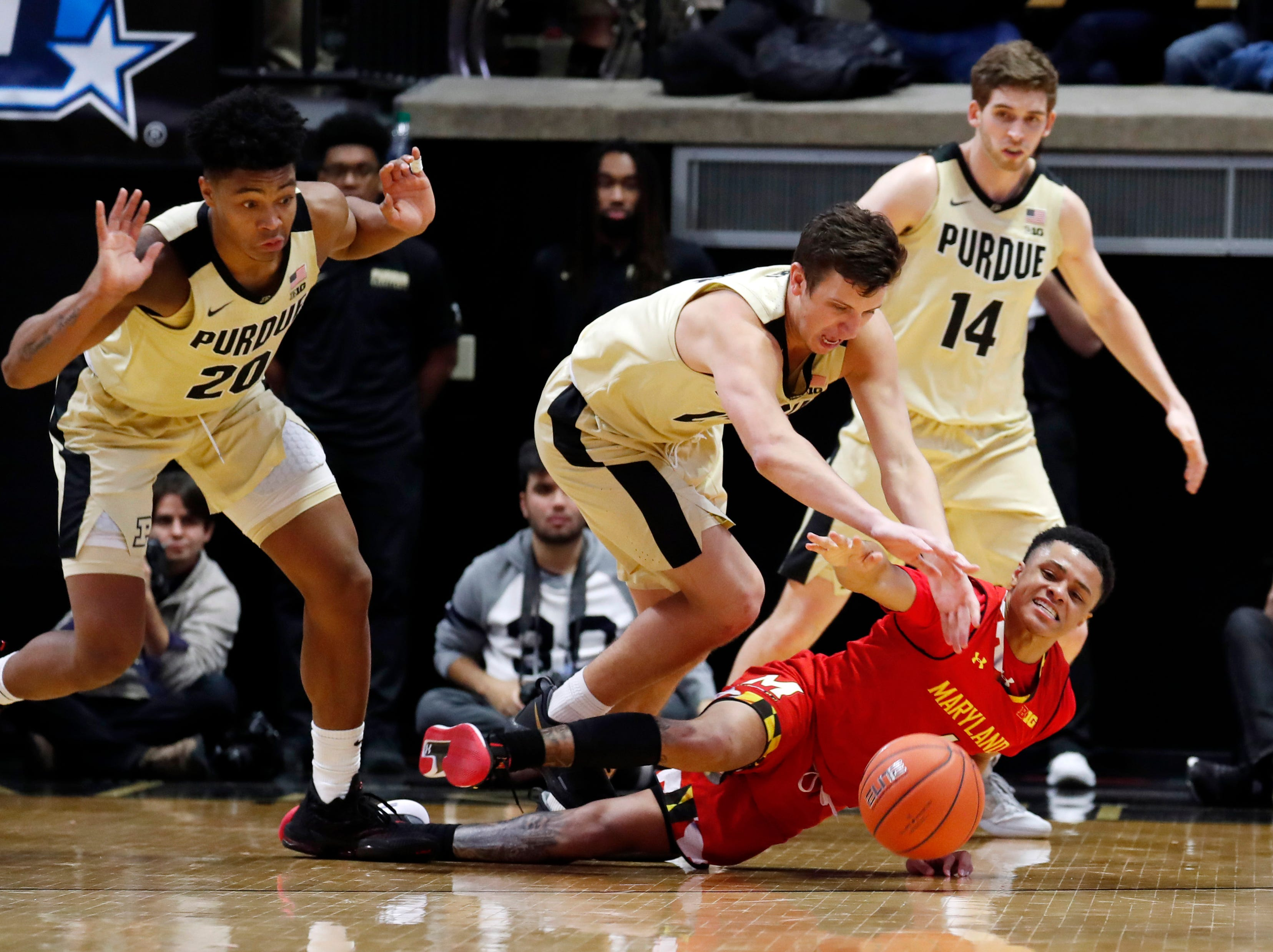 Dec 6, 2018; West Lafayette, IN, USA; Maryland Terrapins guard Anthony Cowan Jr. (1) scrambles for a loose ball against Purdue Boilermakers forward Grady Eifert (24) during the second half at Mackey Arena. Mandatory Credit: Brian Spurlock-USA TODAY Sports
