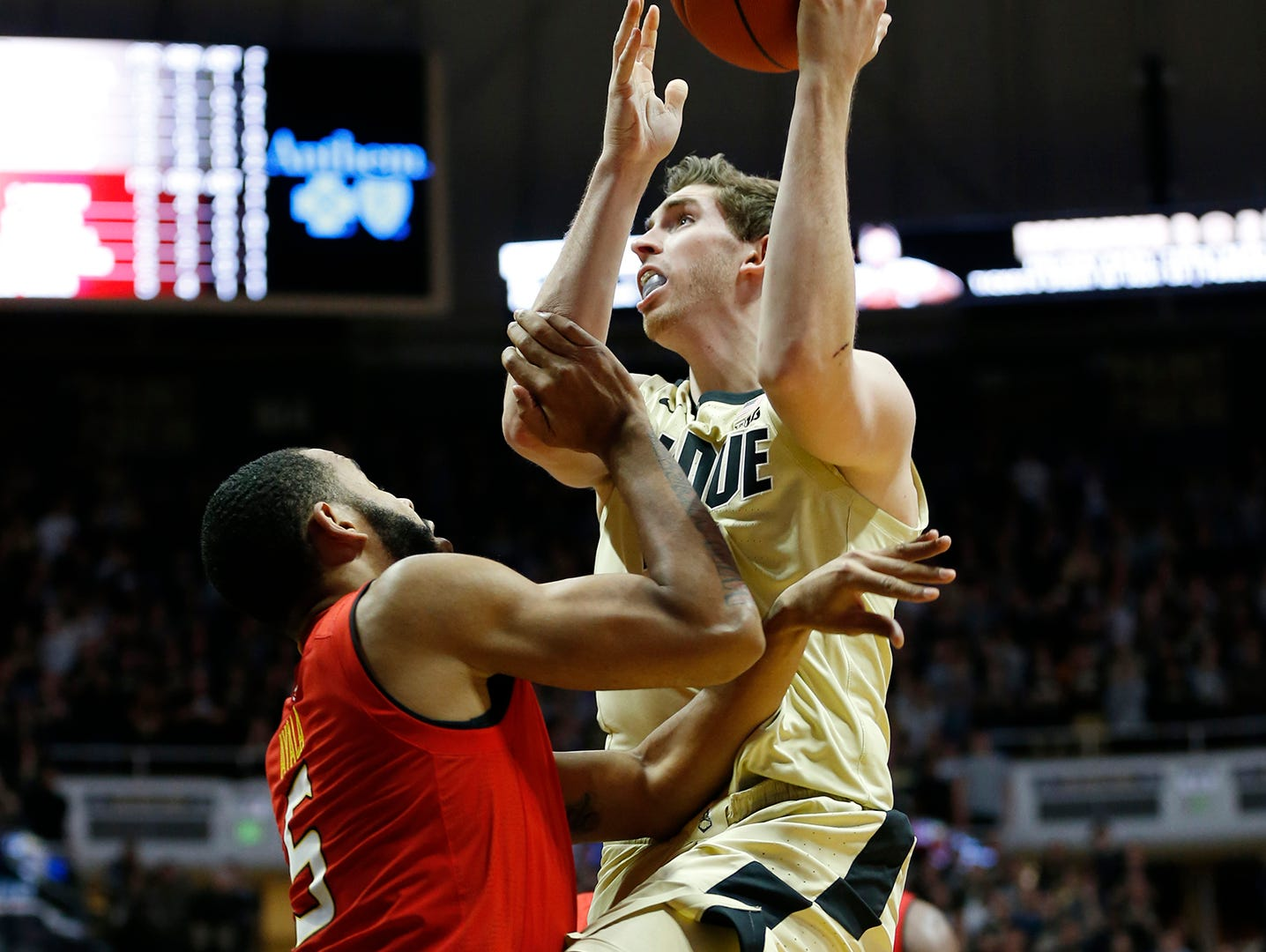 Ryan Cline of Purdue draws a blocking foul on Eric Ayala of Maryland Thursday, December 6, 2018, at Mackey Arena. Purdue defeated Maryland 62-60.