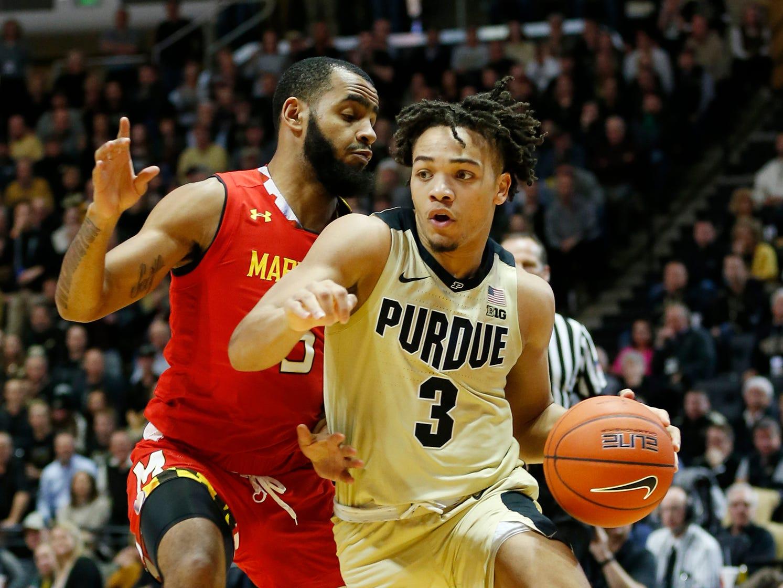 Carsen Edwards of Purdue gets around Eric Ayala of Maryland Thursday, December 6, 2018, at Mackey Arena. Purdue defeated Maryland 62-60.