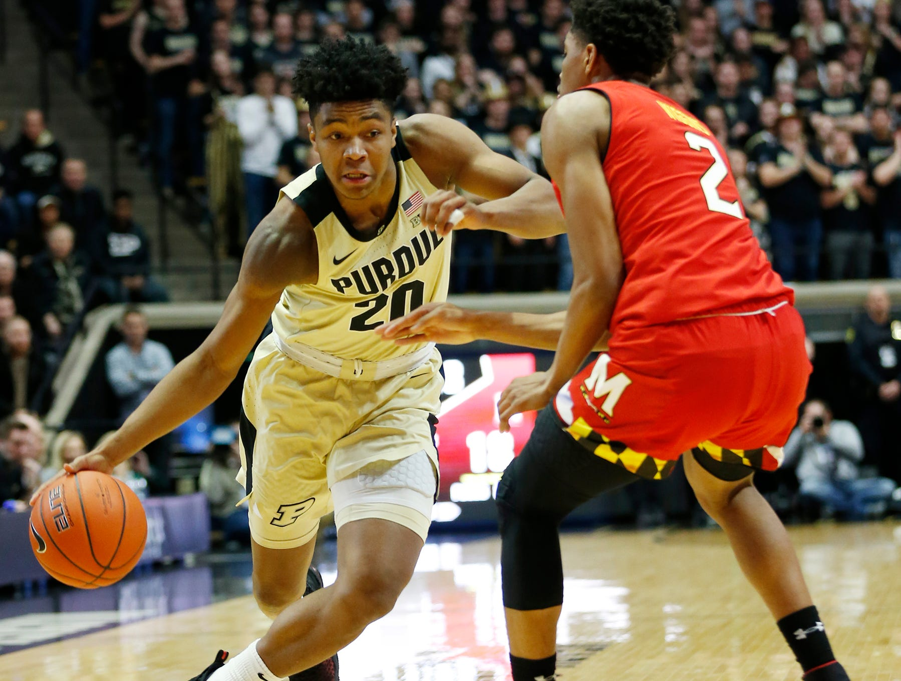 Nojel Eastern of Purdue gets a step on Aaron Wiggins of Maryland Thursday, December 6, 2018, at Mackey Arena.