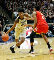 Nojel Eastern of Purdue gets a step on Aaron Wiggins of Maryland, Dec. 6, 2018, at Mackey Arena.