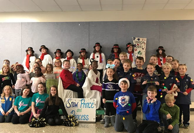 Principal Shannon Cauble at Mayflower Mill Elementary organized a Christmas parade for her students after the Lafayette parade was cancelled.