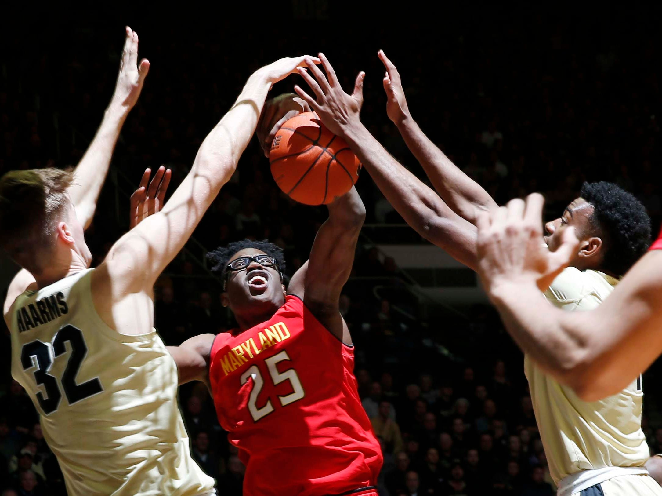 Dec 6, 2018; West Lafayette, IN, USA; Maryland Terrapins forward Jalen Smith (25) has his shot blocked by Purdue Boilermakers center Matt Haarms (32) during the first half at Mackey Arena. Mandatory Credit: Brian Spurlock-USA TODAY Sports