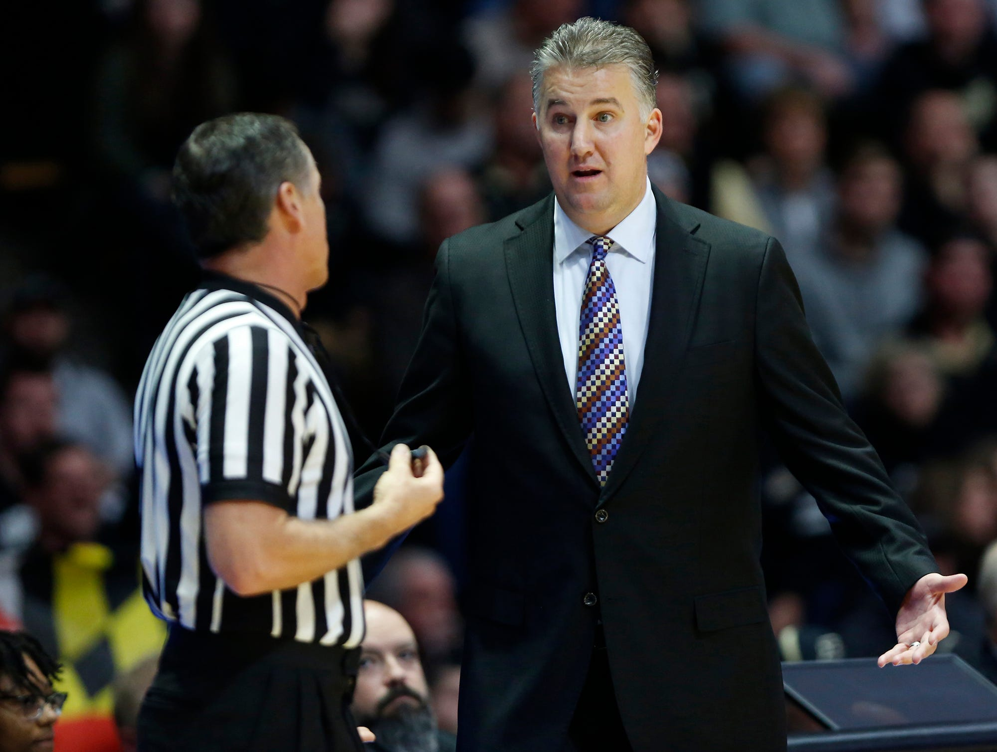 Purdue head coach Matt Painter questions a call by the officials as the Boilermakers battle Maryland Thursday, December 6, 2018, at Mackey Arena. Purdue defeated Maryland 62-60.