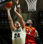 Grady Eifert of Purdue has his shot blocked by Bruno Fernando of Maryland Thursday, December 6, 2018, at Mackey Arena. Purdue defeated Maryland 62-60.