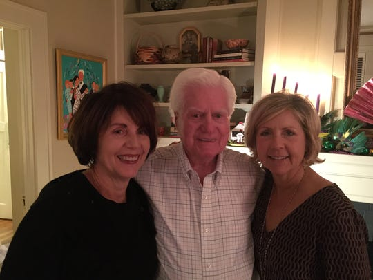 Former Lafayette City councilman Al Simon, center, stands with his two daughters, Michelle Dunaway (left) and Lafayette City-Parish Councilwoman Nanette Cook (right).