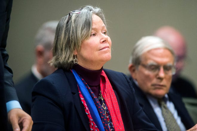Dr. Eden Wells listens as Genesee District Judge William Crawford reads through a prepared statement during a hearing Friday, Dec. 7, 2018, at Genesee District Court in downtown Flint, Mich.