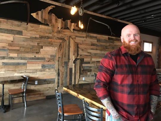 Ministry Ink owner Adam Crane has transformed the space below is second-floor tattoo parlor in Delta Township into The Brew Cafe. The coffee bar, that will eventually offer craft beer and wine is set to open Dec. 17.
