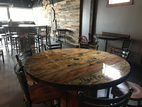 The Brew Cafe, located on the ground floor where Ministry Ink is located off Creyts Road features re-purposed materials, including tables made of large wooden empty electrical spools.