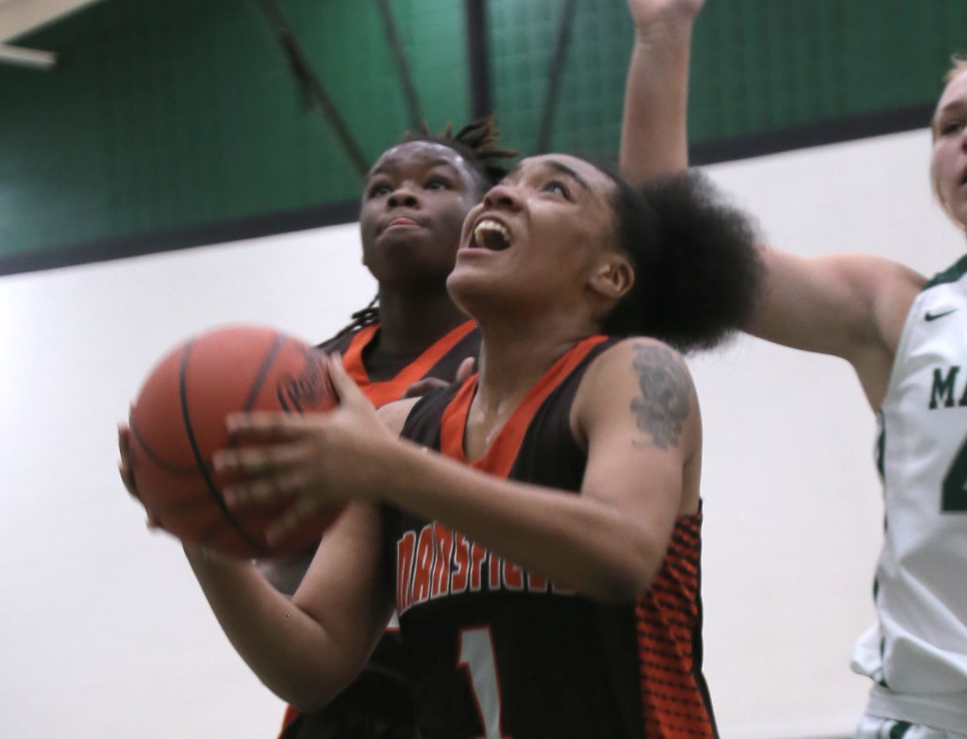 Mansfield Senior's Talayzha Catchings attempts a shot while playing at Madison on Thursday.