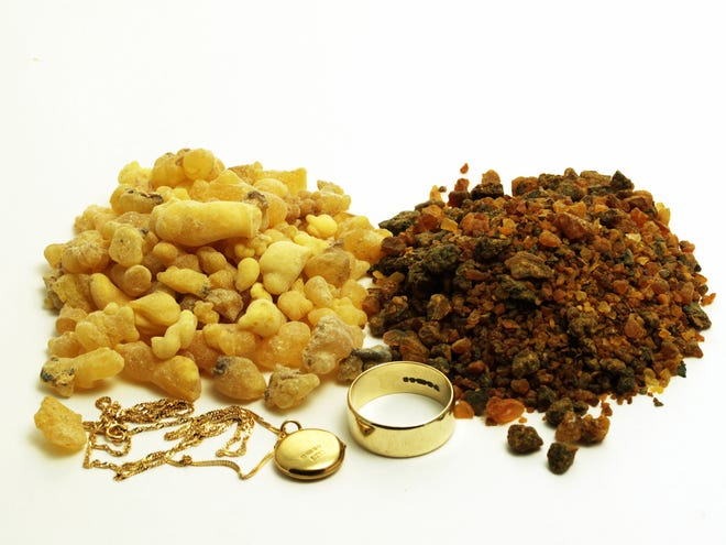 Piles of frankincense and myrrh with gold jewelry.