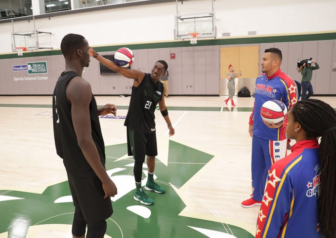The Milwaukee Bucks' Thon Maker (left) and Tony Snell get a few pointers from the Harlem Globetrotters' Orlando El Gato Melendez and Lili Champ Thompson (far right). Members of the Harlem Globetrotters made a stop in Milwaukee on Tuesday to play a little basketball with Bucks players after practice at the Froedtert and the Medical College of Wisconsin Sports Science Center in Milwaukee. The Globetrotters were in town promoting their annual Dec. 31 game at Fiserv Forum.