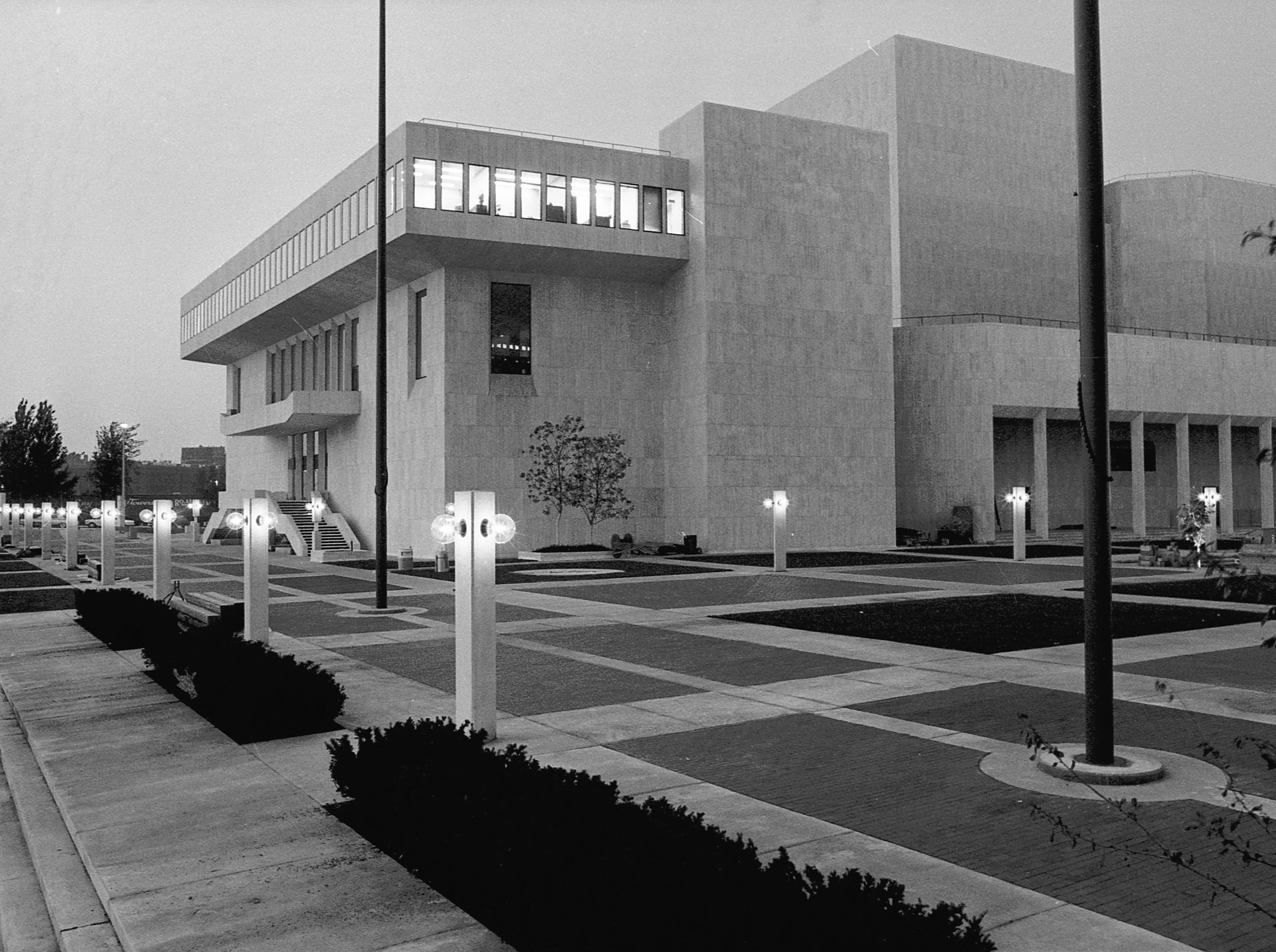 35mm film negative of a night shot of the new Milwaukee Performing Arts Center (now known as the Marcus Center for the Performing Arts) or PAC at 929 N. Water St. Construction began on June 27, 1966. This photo shows the southwest corner of the exterior.   Photo was filed 10/13/1969 Neg #69562 exterior, building, music, performance, stage, theater, Uihlein Hall, Todd Wehr hall, Peck Pavilion.