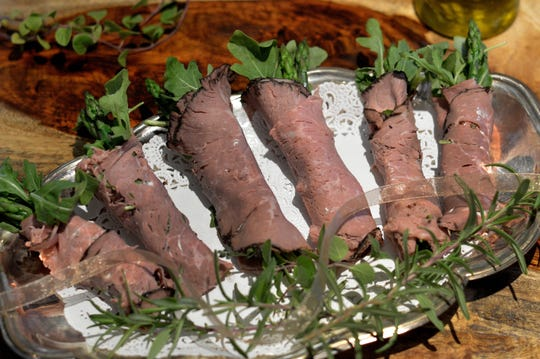 Beef roll-ups enclose asparagus spears in this easy appetizer.