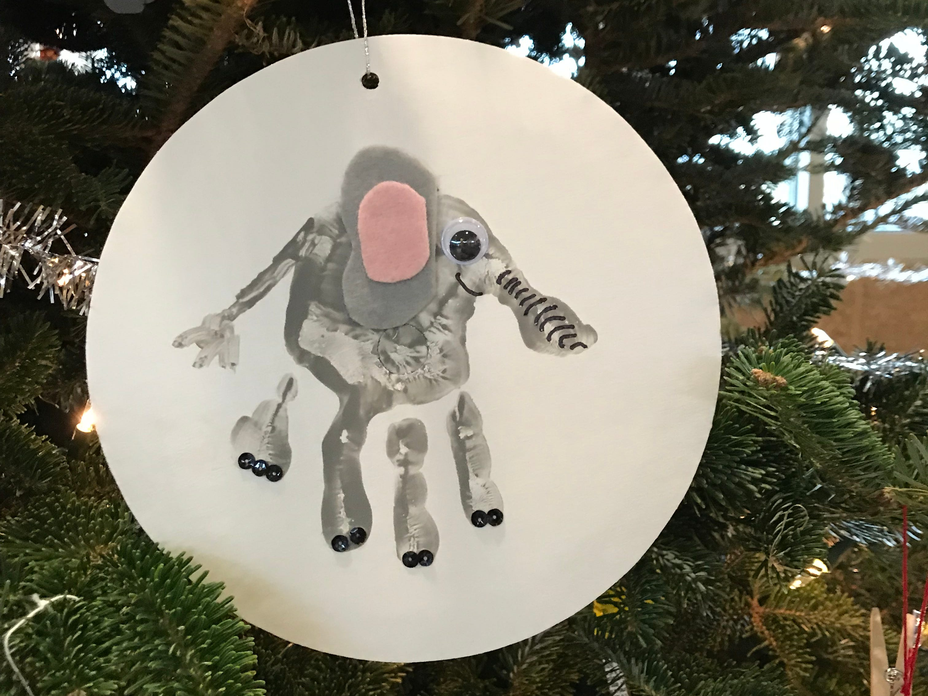 Handprints are one of the most popular ways to make kid art, including ornaments, like this one from the Brookfield Blazers 4H tree at the Milwaukee County Zoo.