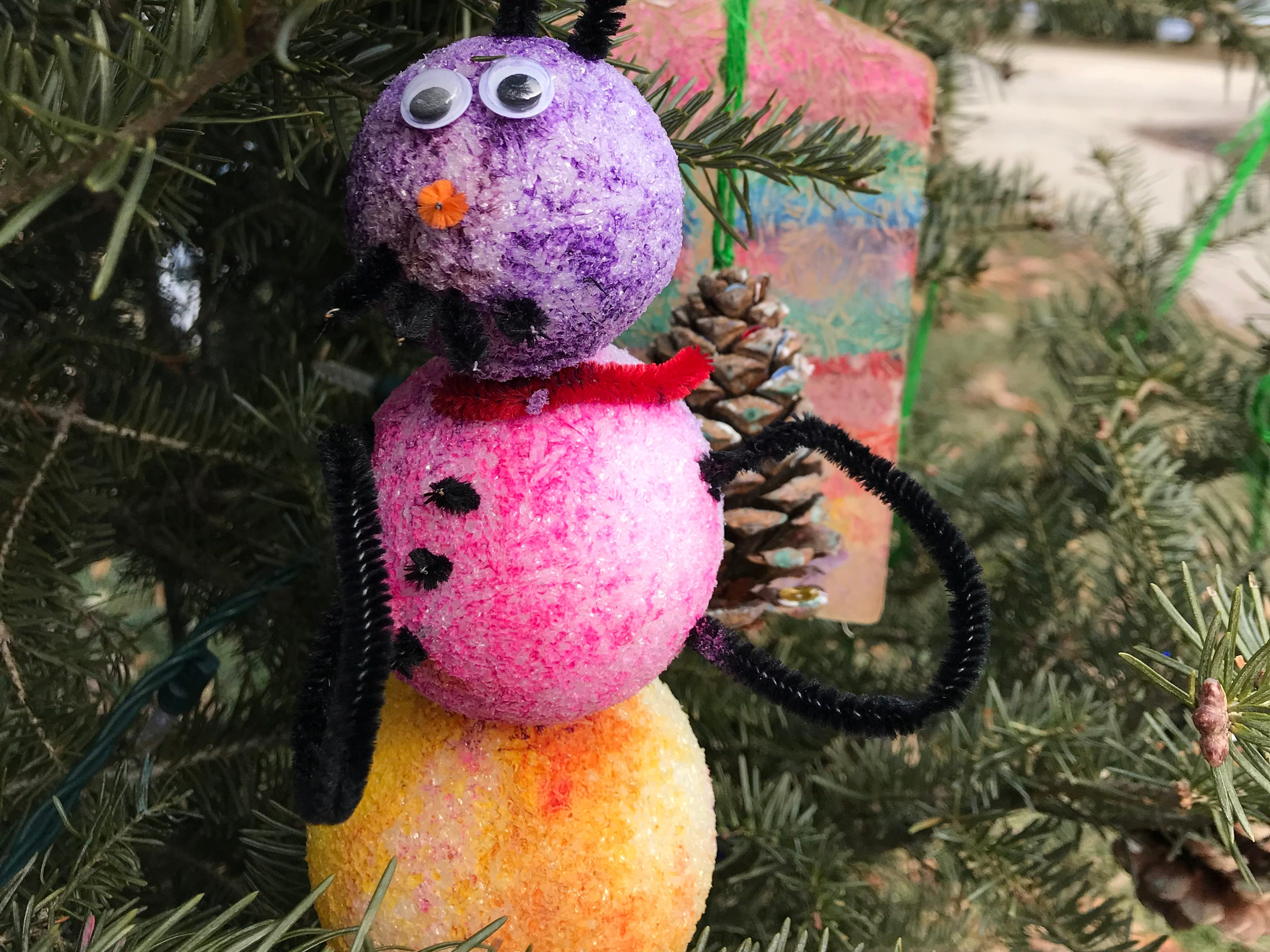 This ornament made from styrofoam balls is on a tree decorated by children from Kluge, on display at Cathedral Square Park.