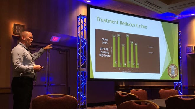 Sgt. Chris DeGlopper of the Greenfield Police Department speaks at a convention in Milwaukee about the CAARE program he runs, which offers addicts a chance at avoiding fines and prison time in exchanging for entering drug treatment.