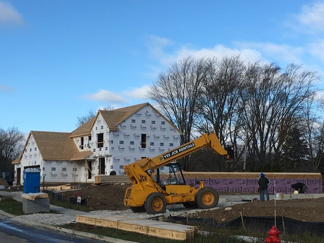 Home construction is up slightly in metro Milwaukee this year. This house was being built in November in Menomonee Falls.