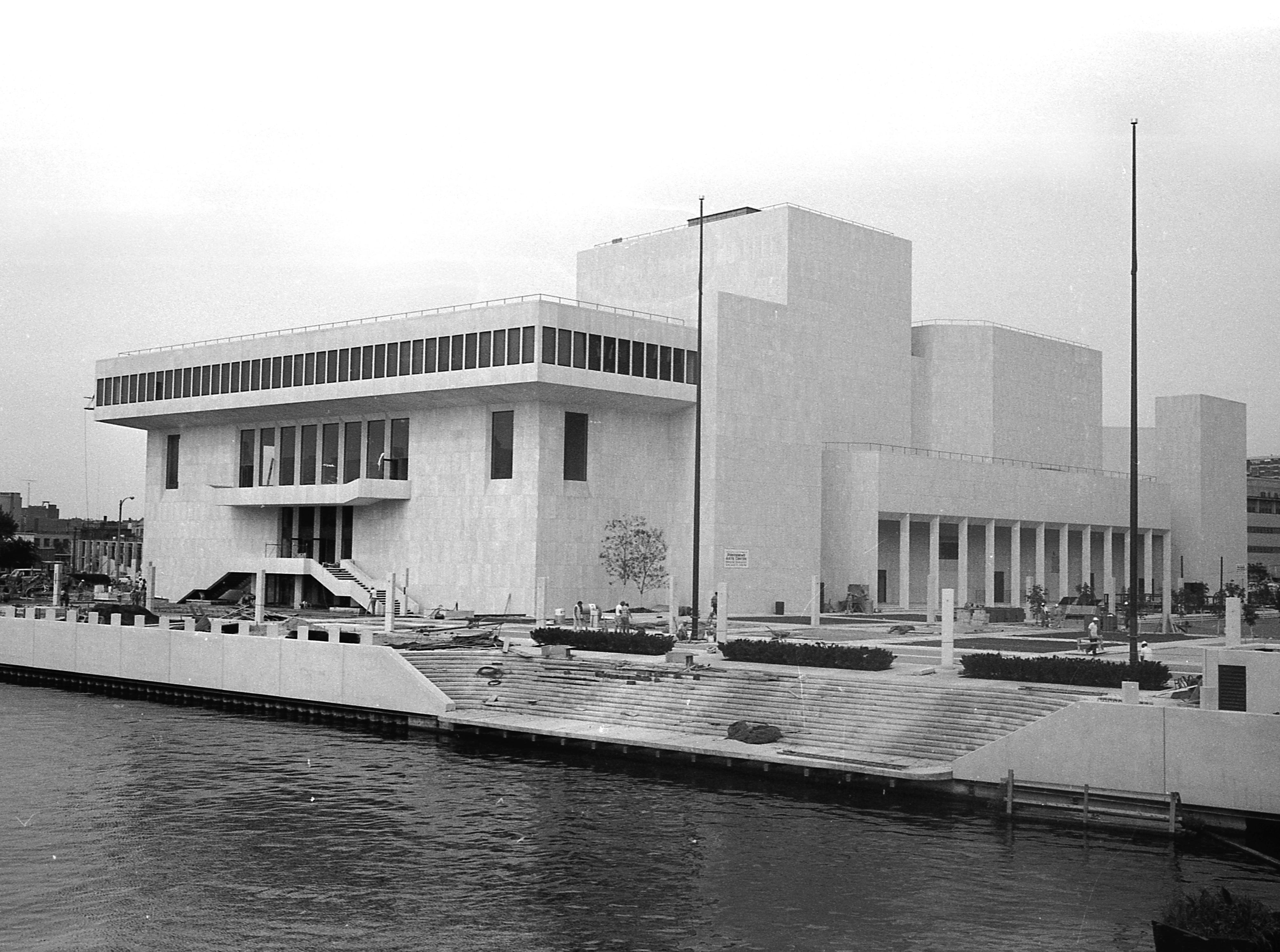 35mm film negative of the new Milwaukee Performing Arts Center (now known as the Marcus Center for the Performing Arts) or PAC at 929 N. Water St. Construction began on June 27, 1966. This photo shows the southwest exterior looking from the Kilbourn Ave. bridge.   Photo was filed 10/7/1969. Neg #69546 exterior, building, music, performance, stage, theater, Uihlein Hall, Todd Wehr hall, Peck Pavilion.