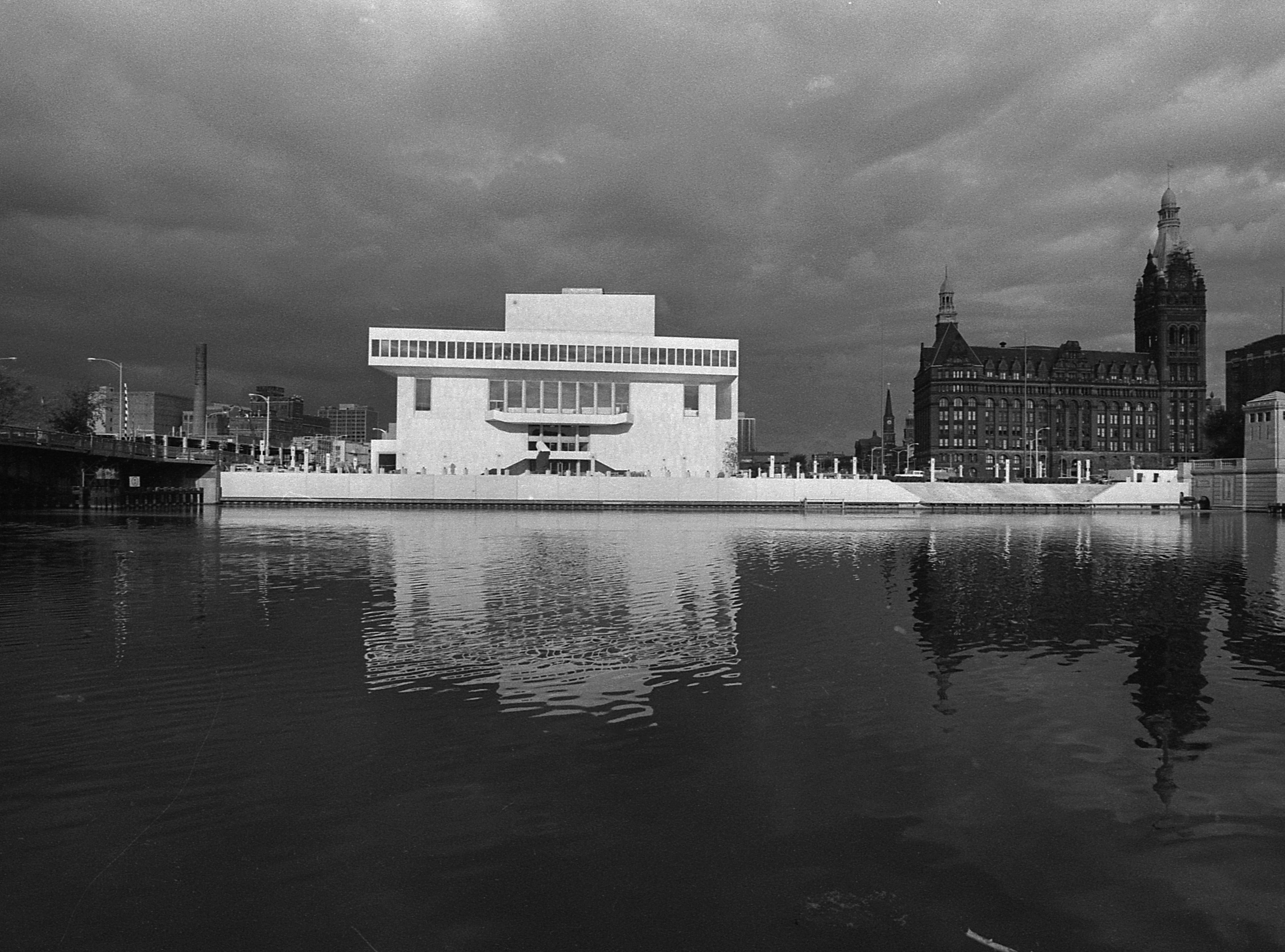 35mm film negative of the new Milwaukee Performing Arts Center (now known as the Marcus Center for the Performing Arts) or PAC at 929 N. Water St. Construction began on June 27, 1966. This photo shows the west side of the exterior from across the river. City Hall is on the right.   Photo was filed 10/13/1969 . Neg #69561 exterior, building, music, performance, stage, theater, Uihlein Hall, Todd Wehr hall, Peck Pavilion.