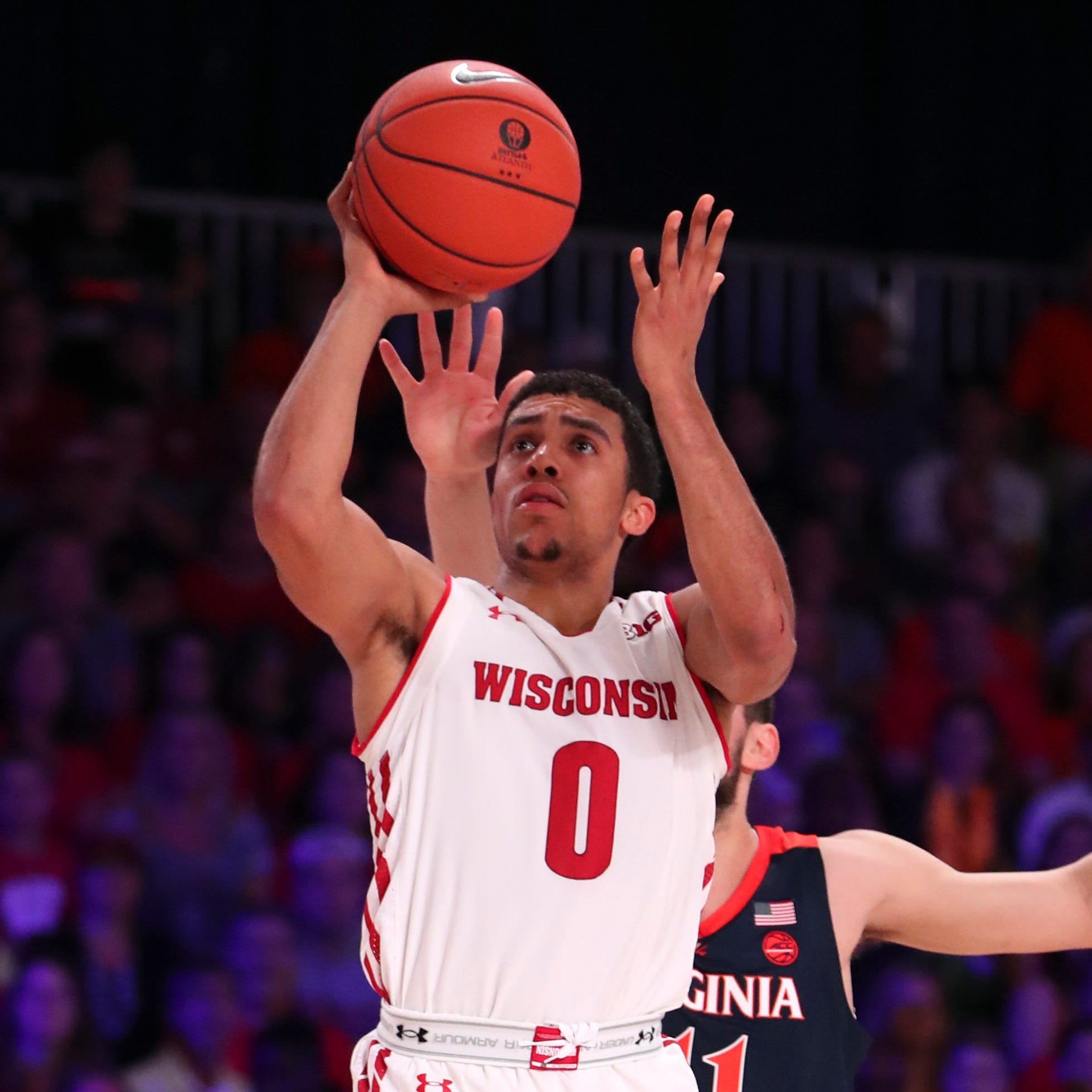 UW's D'Mitrik Trice and Kobe King hope to be playmakers rather than spectators against Marquette