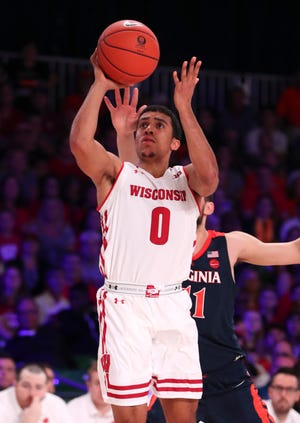 Wisconsin guard D'Mitrik Trice, who missed the Marquette game last season with a broken foot, is leading the nation in three-point shooting this season.