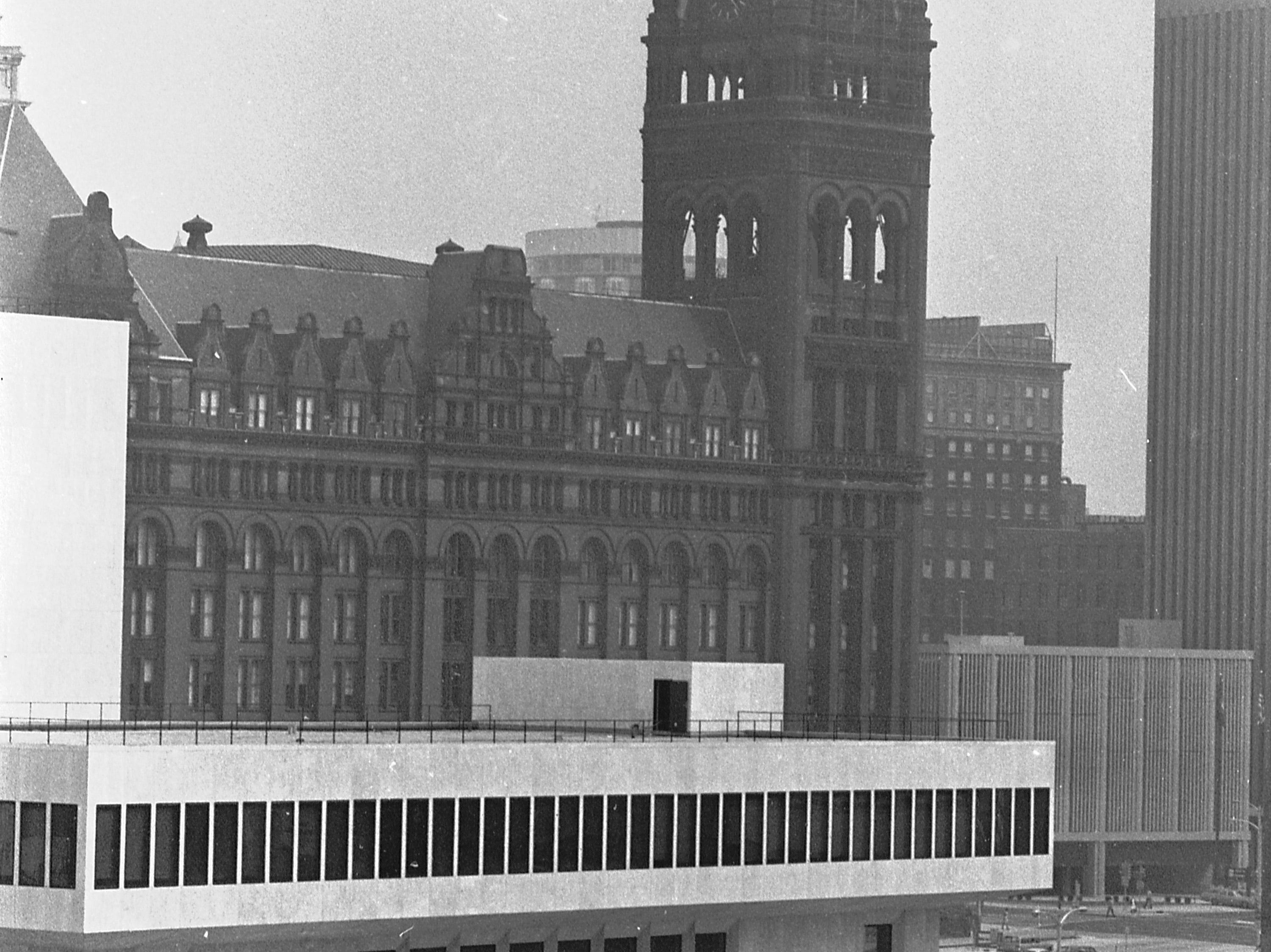 """35mm film negative of the new Milwaukee Performing Arts Center (now known as the Marcus Center for the Performing Arts) or PAC at 929 N. Water St. Construction began on June 27, 1966. This photo was in the Sept. 16 edition of the Sentinel with the caption """"The city hall sets off this riverfront view of the Performing Arts Center. This side has entrances to the Todd Wehr Theater and Bradley pavilion. Background also includes the new Marshall & Ilsley band (right center) and the Pfister hotel (top center). Drive from Kilbourn av. to State st. is in foreground.""""  Date is 9/16/1969. Neg. #69591 exterior, building, music, performance, stage, theater, Uihlein Hall, Todd Wehr hall, Peck Pavilion."""