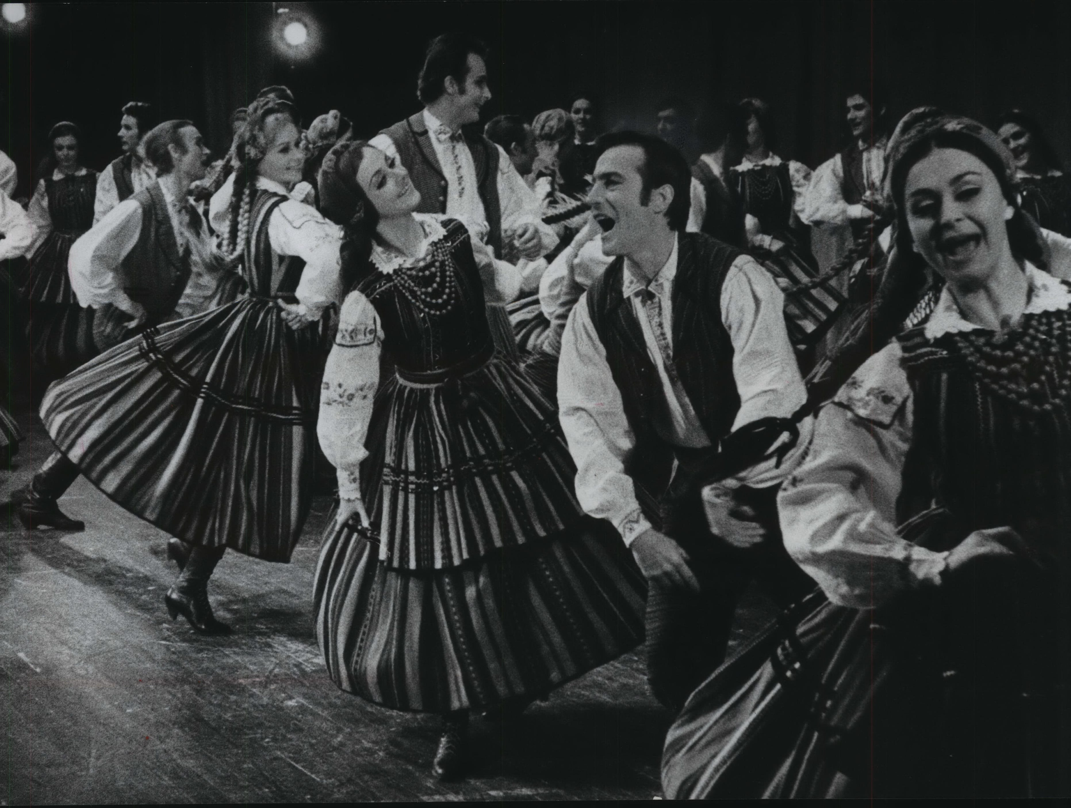 Evening Delight - Members of Mazowsze, Poland's national song and dance company, whirled through a number Wednesday in the Performing Arts Center in Milwaukee, Wisconsin.  The appearance was sponsored by the Distinguished Concerts Guild. (Story on Page 10.)