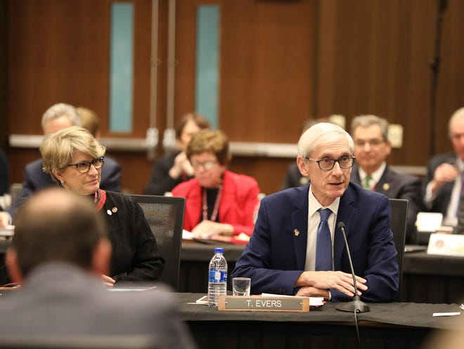 Democrat governor-elect Tony Evers speaks at the University of Wisconsin System Board of Regents meeting on the UW-La Crosse campus. He is seated next to past president Regina Millner.