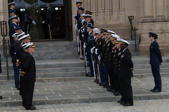 During the funeral for former President George H.W. Bush, Nicholas Vukmir of Wauwatosa stood outside the Washington National Cathedral on Wednesday with a line of other soldiers on each side.