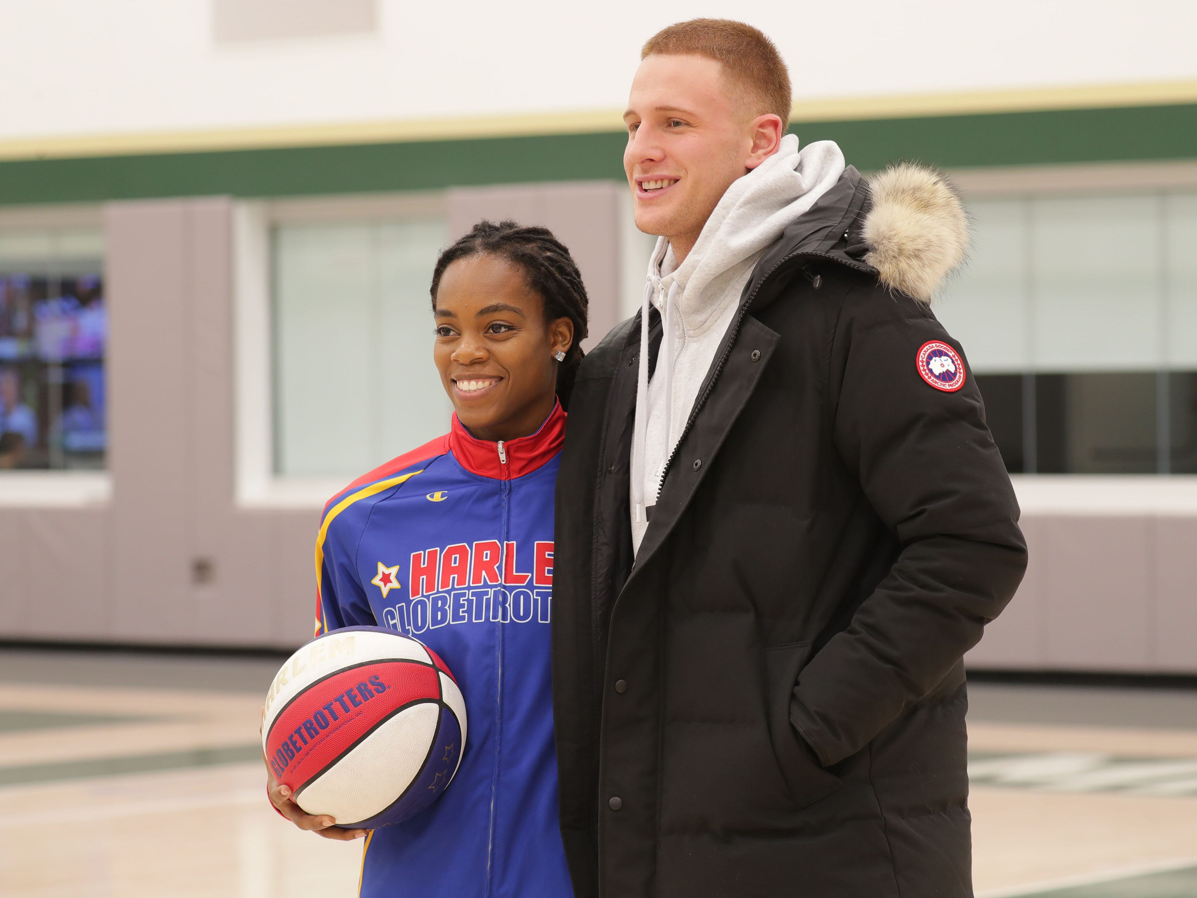 Harlem Globetrotter Lili Champ Thompson poses for a photo with the Milwaukee Bucks' Donte DiVincenzo at the Froedtert and the Medical College of Wisconsin Sports Science Center in Milwaukee..