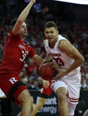 Dec 3, 2018; Madison, WI, USA; Wisconsin Badgers guard Kobe King (23) drives to the basket as Rutgers Scarlet Knights guard Peter Kiss (32) starts to strip the ball at the Kohl Center. Mandatory Credit: Mary Langenfeld-USA TODAY Sports