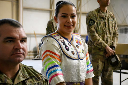 Army Pfc. Loretta Menchaca, 21, prepares to dance in traditional garb during a powwow at Camp Buehring in Kuwait Nov. 27.