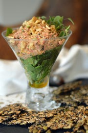 Walnut and red pepper dip can be served with crackers of your choice.