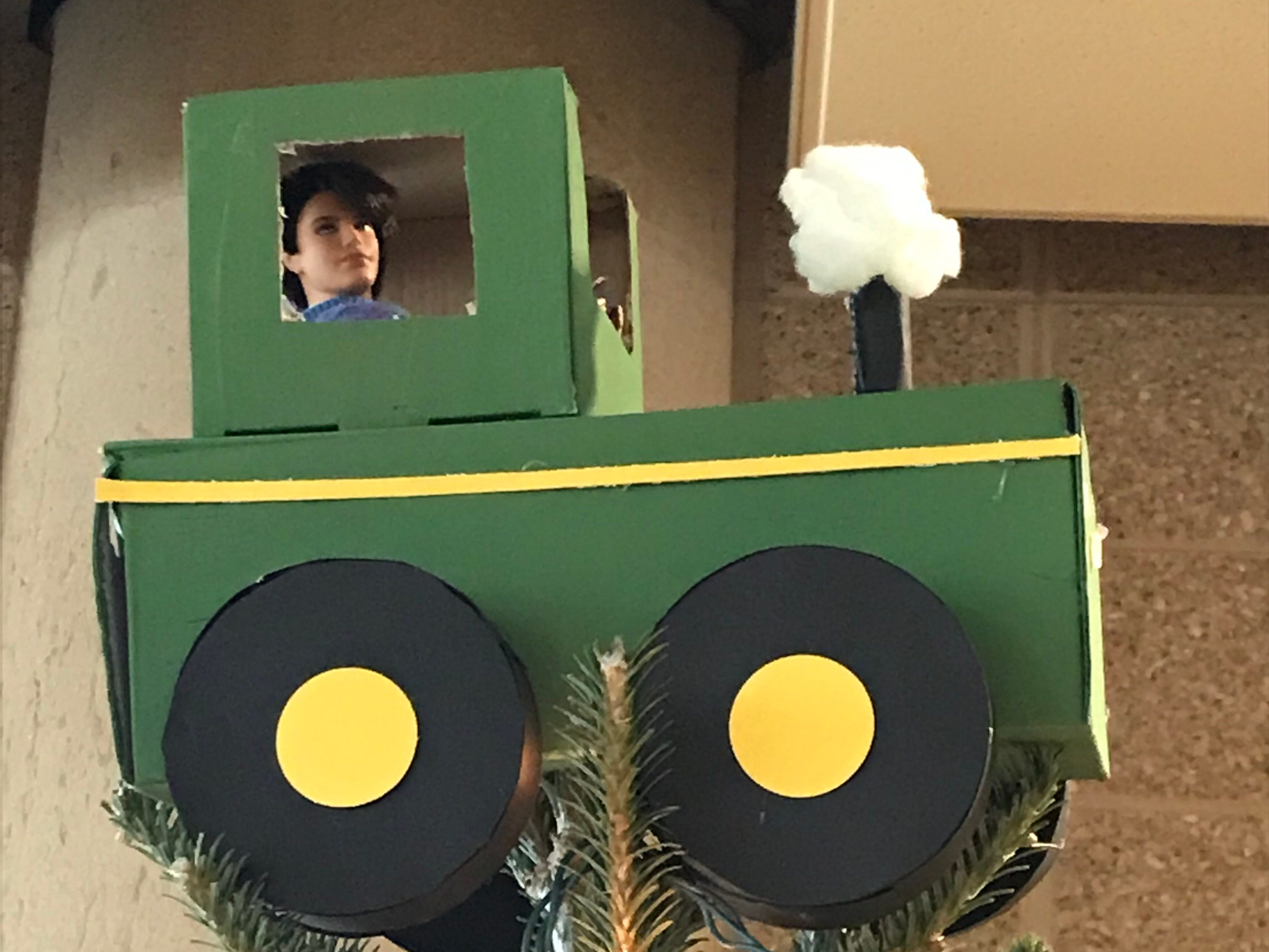 Even tree toppers can be homemade, like this tractor on a tree at the Milwaukee County Zoo, made by children from Forest Park.