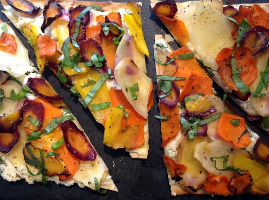 Multicolored carrots make for a pretty (and healthy) flatbread appetizer.