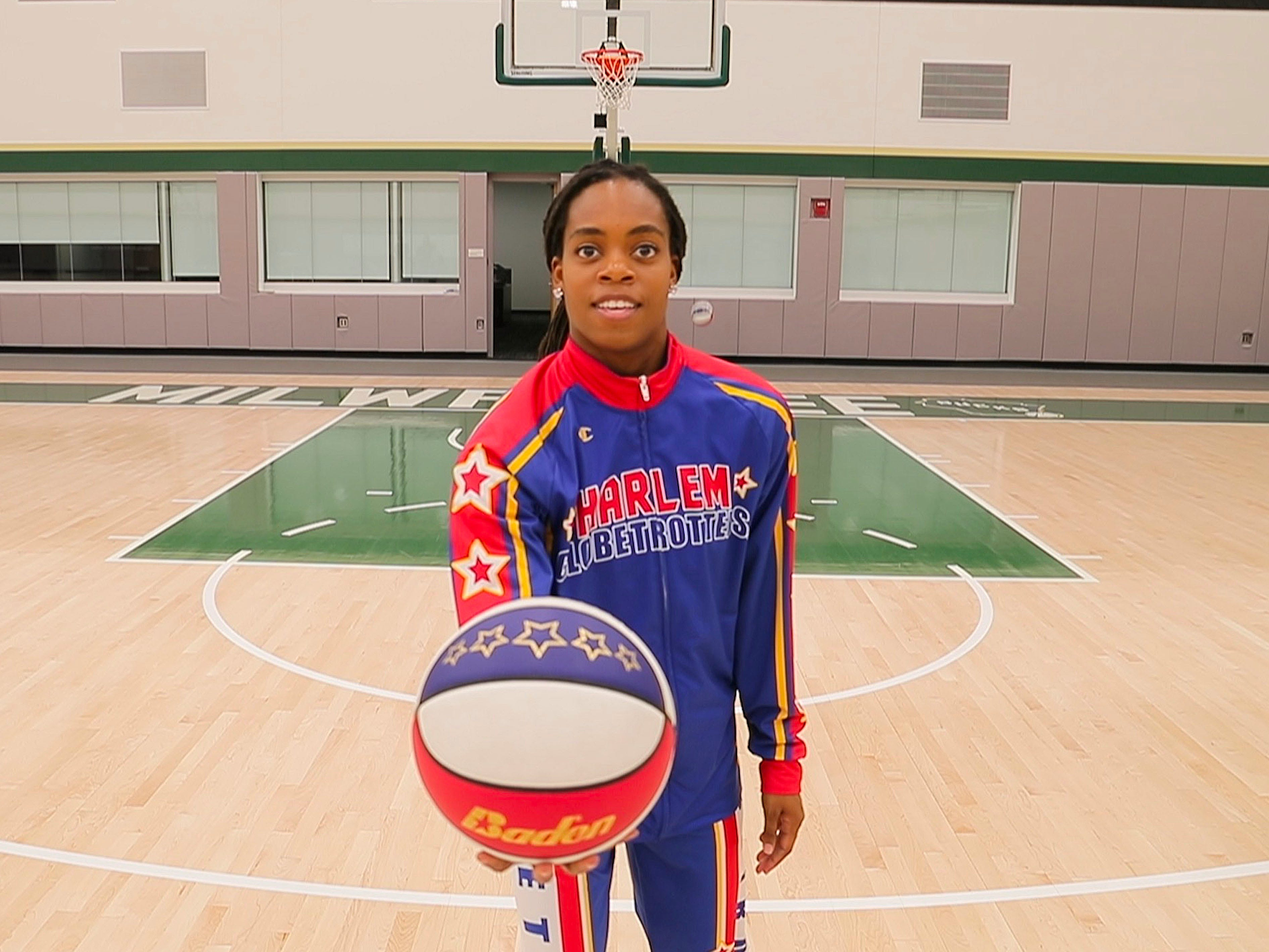 The Harlem Globetrotters' Lili Champ Thompson prepares to shoot a behind-the-back shot, which she made. The Globetrotters were in town promoting their annual Dec. 31 game at Fiserv Forum.