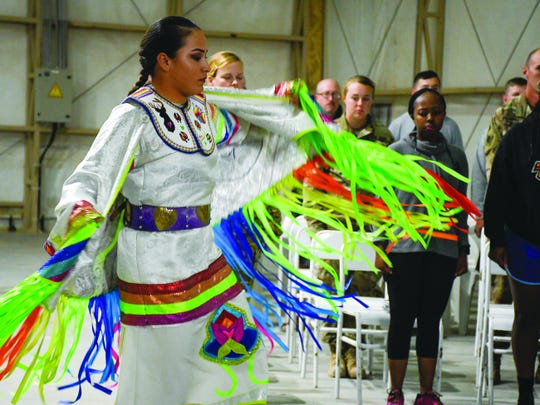Army Pfc. Loretta Menchaca, 21, dances during a powwow at Camp Buehring in Kuwait Nov. 27.