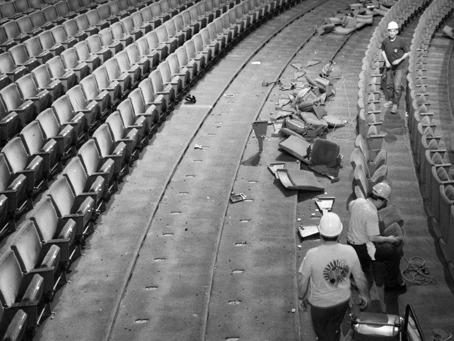 Workers remove seats during the start of a 5-month-long renovation project of Uihlein Hall at the Marcus Center for the Performing Arts on June 16, 1997 in MIlwaukee, Wis.(MIlwaukee Journal Sentinel photo by Rick Wood)