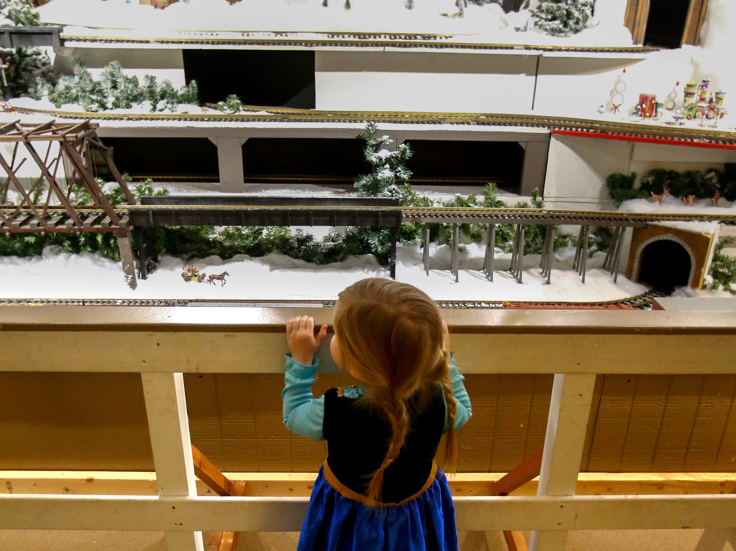 Eber Allen of Genesee looks at the five-tier running display of G-scale trains at the Country Christmas at the Ingleside Hotel in Pewaukee. The Country Christmas display is open 5 p.m. to 9 p.m. Sundays through Thursdays, and 5 p.m. to 10 p.m. Friday and Saturdays.