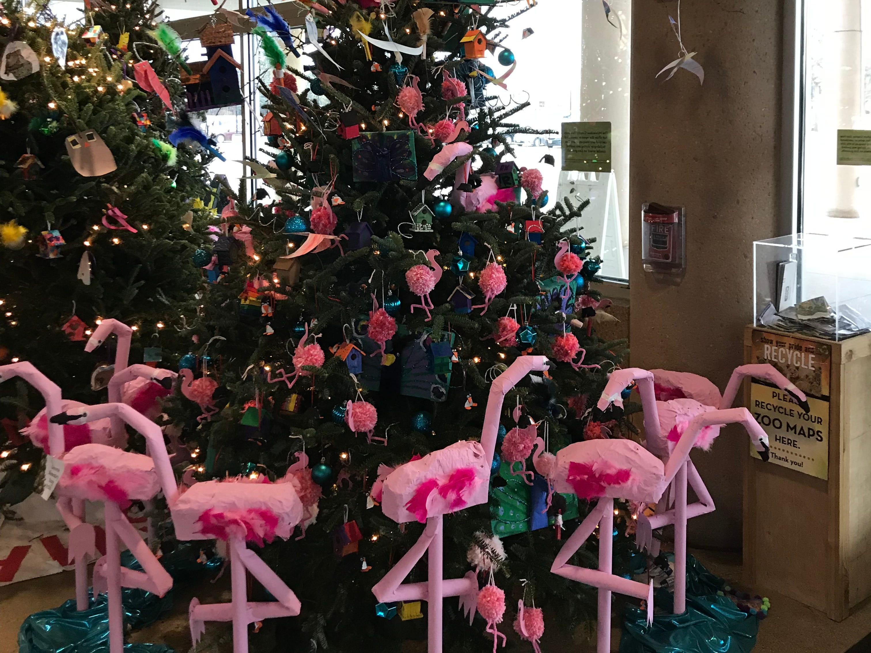 The Christmas trees at the zoo are decorated according to the different areas at the zoo. This one, by Decorah Elementary, is one of the bird trees.