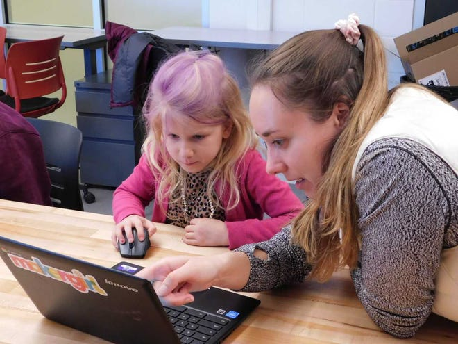 Stephanie Hein works with a student at one of MakerGirl's sessions held at the University of Illinois.