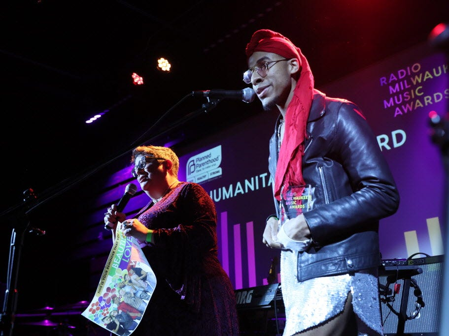 Kathy Flores and Lex Allen accept the Humanitarian Award at the Radio Milwaukee Music Awards Thursday on behalf of Diverse and Resilient, a local organization dedicated to improving the safety and well-being of the LGBTQ community in Wisconsin. Local musician Allen was part of the organization's Colors in Bloom campaign.