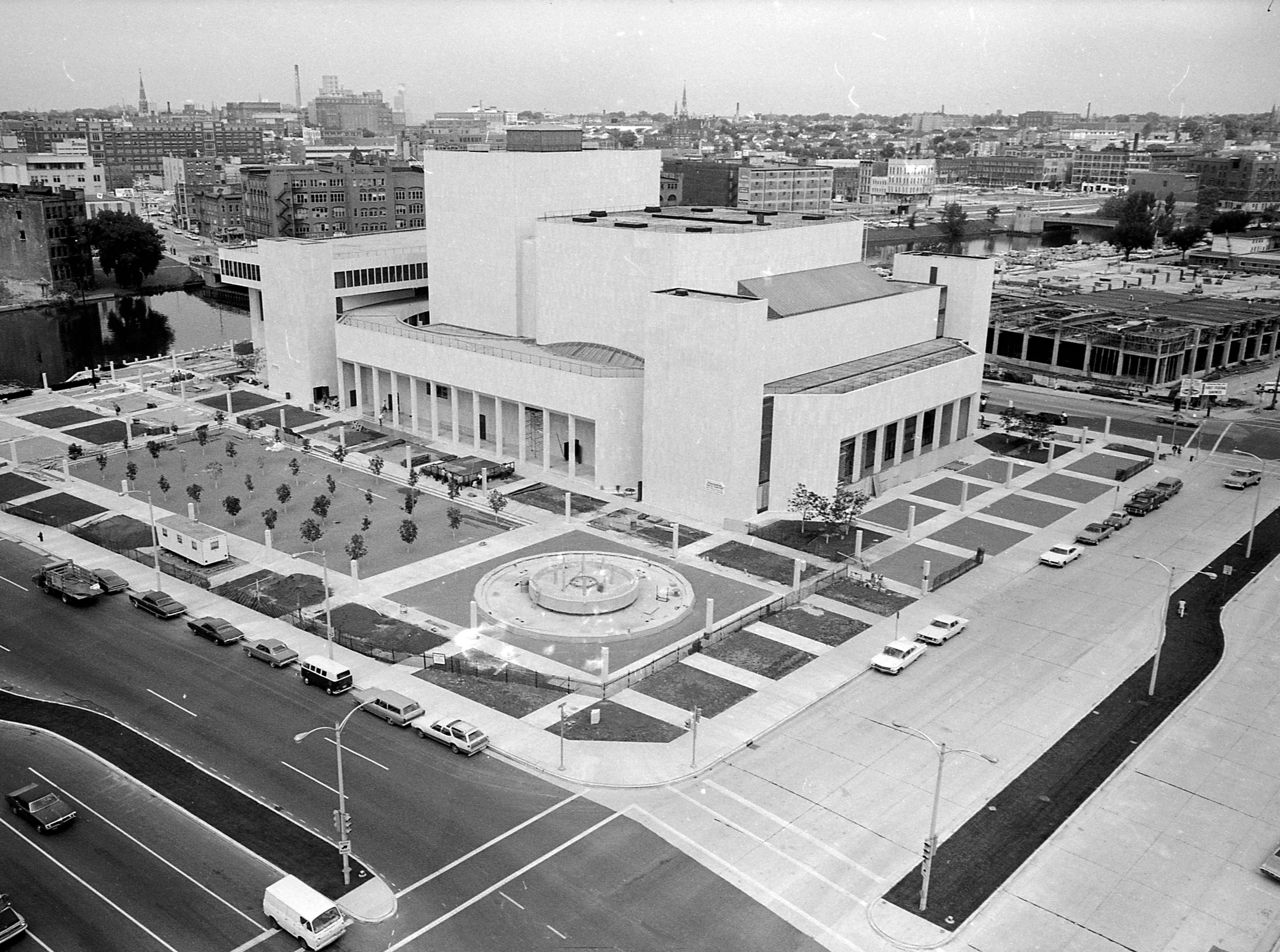 35mm film negative of the new Milwaukee Performing Arts Center (now known as the Marcus Center for the Performing Arts) or PAC at 929 N. Water St. Construction began on June 27, 1966. This photo shows the exterior looking northwest from the corner of Water St. and Kilbourn Ave.   Photo was filed 10/7/1969 Neg #69546 exterior, building, music, performance, stage, theater, Uihlein Hall, Todd Wehr hall, Peck Pavilion.