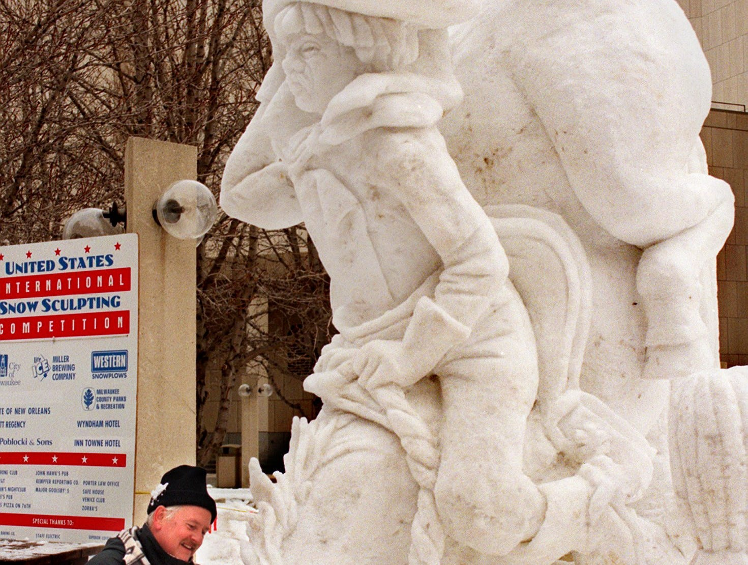 Snow Sculpt-Horse, 1/31/98, Walicki, Jeff Olson, of Muskego, puts finishing touches on a snow sculpture titled 'Wild West' Saturday shortly before judging of the International Snow Sculpting competition held at the Marcus Center for Performing Arts.