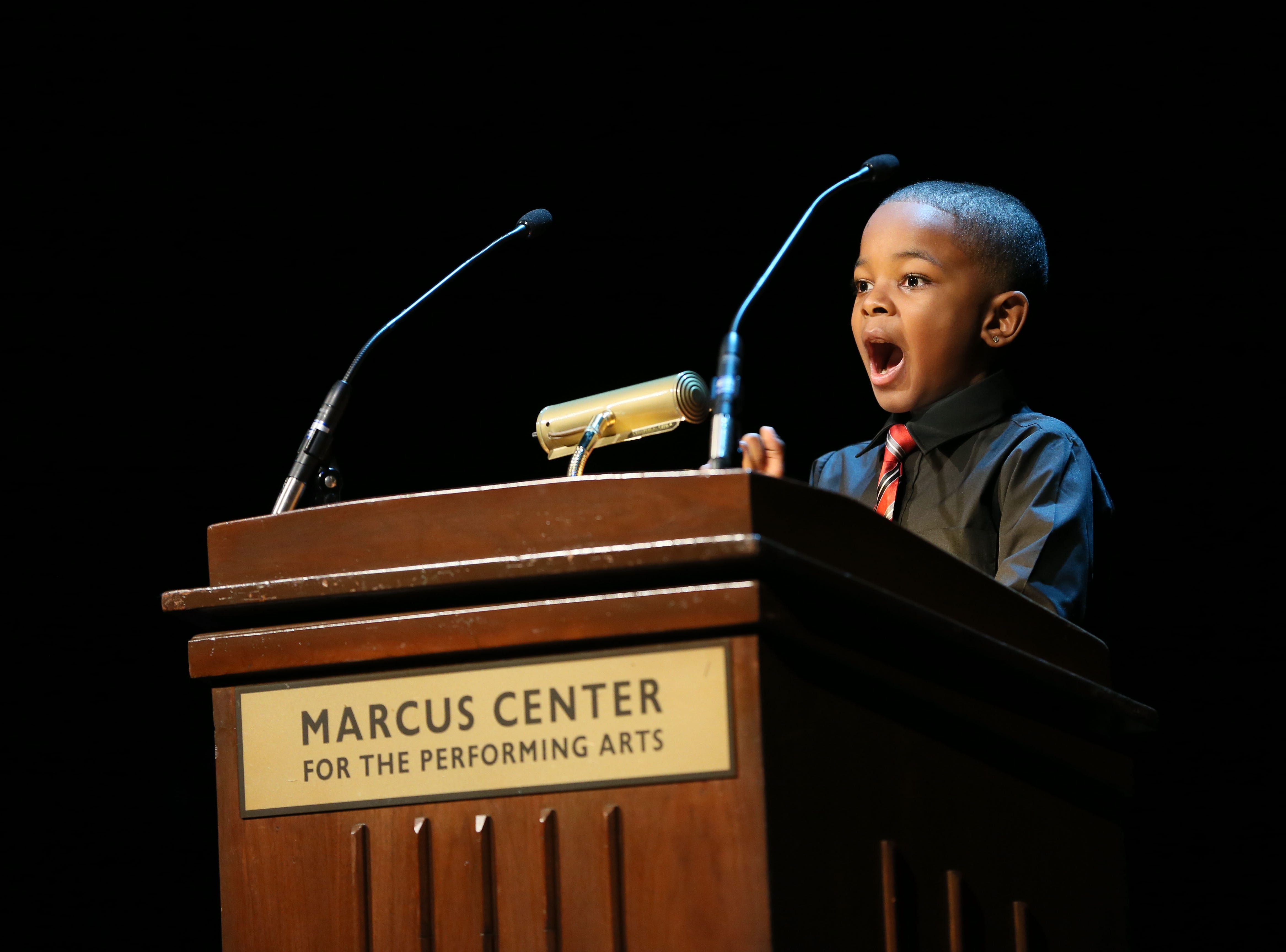 January 17, 2016 Photograph from the Dr. Martin Luther King, Jr. Birthday Celebration held at the Marcus Center for the Performing Arts in Milwaukee.   Jordan Cameron, a second grader from Hawthorne Elementary School as he gave the speech that made him one of the speech constest winners.  He received a standing ovation from the crowd after his rousing delivery. MICHAEL SEARS/MSEARS@JOURNALSENTINEL.COM