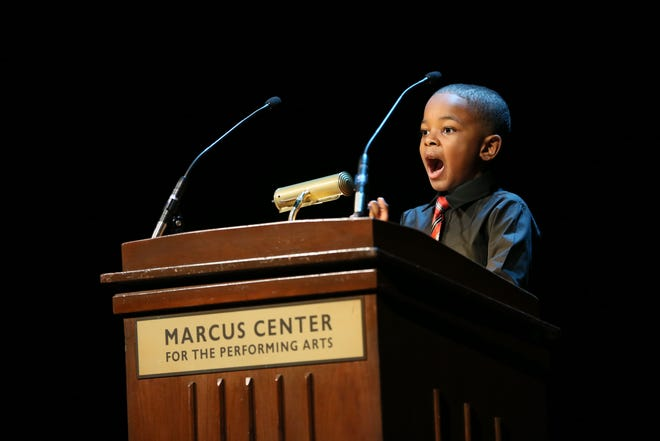 Jordan Cameron, a second grader from Hawthorne Elementary School in Milwaukee, Wisconsin, gives a speech at Milwaukee's Marcus Center on Martin Luther King Jr. Day 2016. On MLK Day in 2019, students in grades 6-12 will be able to participate in a King recitation competition in Asheville.