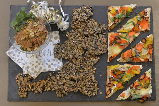 Walnut dip with crackers and carrot flatbread both make alluring appetizers.