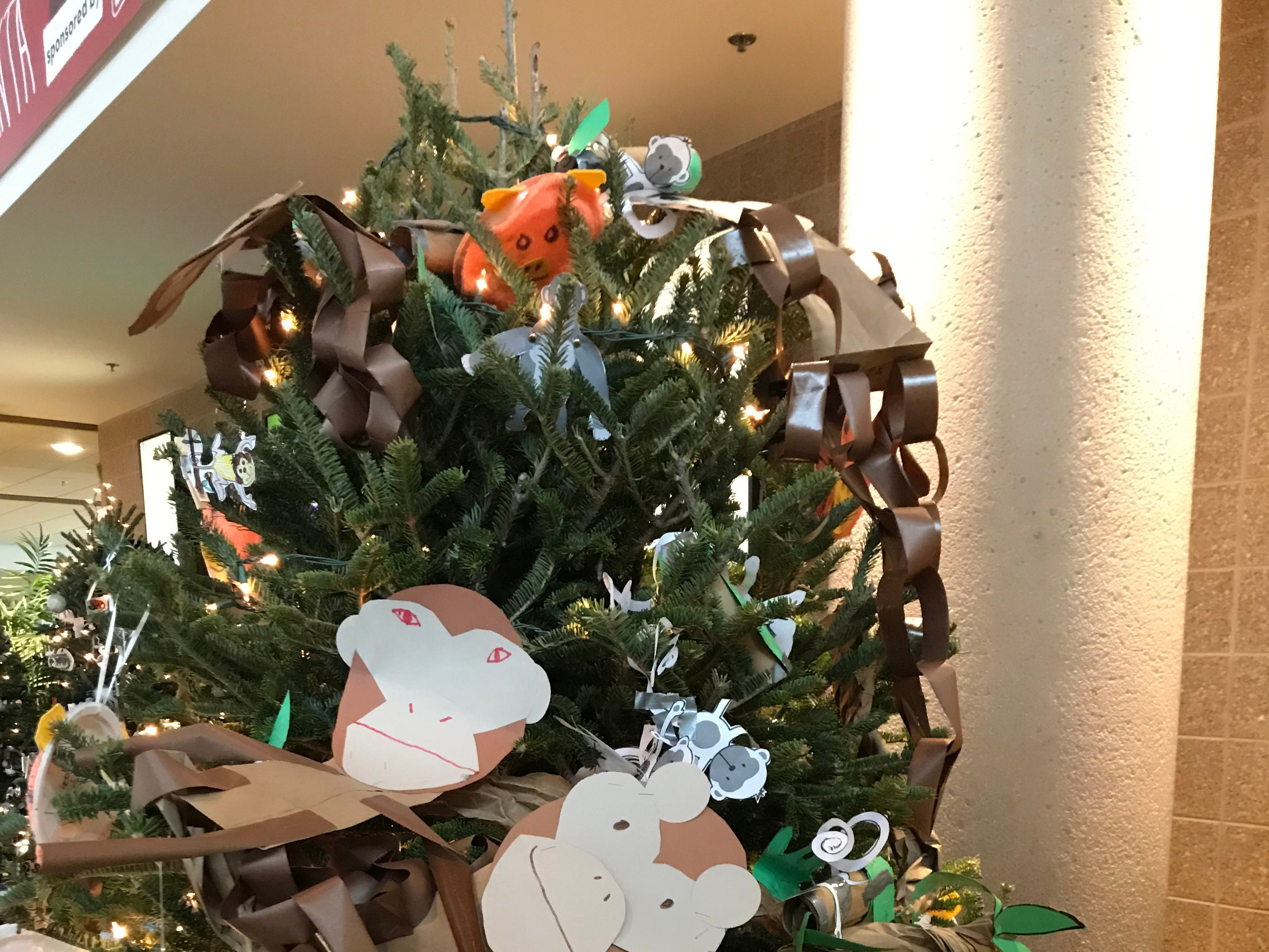 Children from Wauwatosa Catholic School decorated their tree with monkey-themed ornaments at the Milwaukee County Zoo.